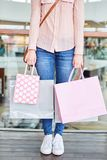Female customer with many shopping bags. As a symbol of consumption and purchasing power Stock Photography