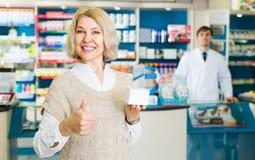 Female customer in pharmacy drugstore Royalty Free Stock Images