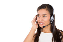 Female customer representative in hands free device, carefully listening a customer Royalty Free Stock Photos