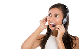 Female customer representative in hands free device, carefully listening a customer Royalty Free Stock Image