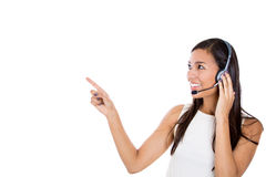 Female customer representative in hands free device, carefully listening a customer Royalty Free Stock Photography