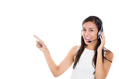 Female customer representative in hands free device, carefully listening a customer Royalty Free Stock Images