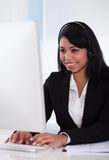 Female customer representative using computer Royalty Free Stock Photos