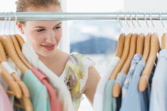 Female customer selecting clothes at store Stock Photo