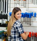 Female Customer Selecting Screwdriver In Hardware Royalty Free Stock Images