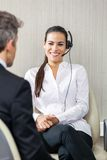 Female Customer Service Agent Looking At Manager Stock Photos