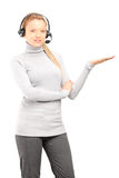 Female customer service operator with headphones gesturing Stock Photos