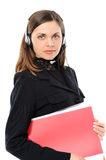 Female customer service representative. Young female customer service representative in headset  with a folder  On a white background Royalty Free Stock Photo