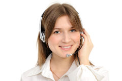 Female customer service representative. Young female customer service representative in headset, smiling  on a white background Royalty Free Stock Photography