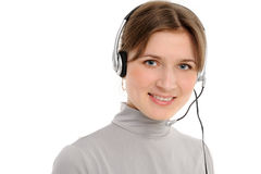 Female customer service representative. Young female customer service representative in headset, smiling  on a white background Royalty Free Stock Image