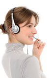 Female customer service representative. Young female customer service representative in headset, smiling  on a white background Stock Photos