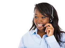 Female customer service representative with hands free device Royalty Free Stock Image