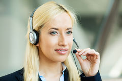 Female customer service representative on hands free device Royalty Free Stock Photo