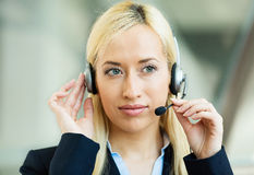 Female customer service representative on hands free device Royalty Free Stock Image