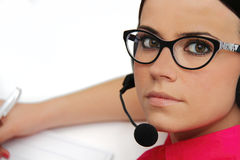 Female customer service representative with headse Royalty Free Stock Image