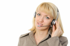 Female customer service representative in headset. Young female customer service representative in headset. Isolated on white background Stock Photos