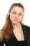 Female customer service representative in headset. Young female customer service representative in headset Royalty Free Stock Photo