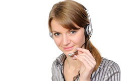 Female customer service representative in headset. Young female customer service representative in headset, smiling  on a white background Royalty Free Stock Photography