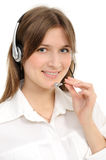 Female customer service representative in headset. Young female customer service representative in headset, smiling  on a white background Stock Photography