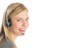 Female Customer Service Representative Wearing Headset. Close-up portrait of happy female customer service representative wearing headset isolated over white Royalty Free Stock Image