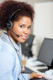 Female Customer Service Representative Wearing. Portrait of young female customer service representative wearing headset in office Royalty Free Stock Image