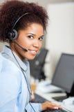 Female Customer Service Representative Wearing Royalty Free Stock Image