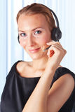 Female customer service representative working. Closeup of a female customer service representative working with headset. Can I help you Stock Photos