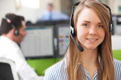 Female Customer Services Agent In Call Centre Stock Photo