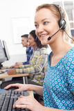 Female Customer Services Agent In Call Centre Stock Photography