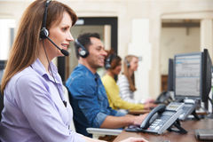 Female Customer Services Agent In Call Centre. Customer Services Agents In Call Centre Stock Images