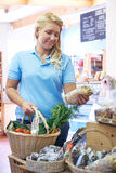 Female Customer Shopping In Farm Shop Royalty Free Stock Image