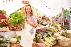 Female Customer Shopping At Farmers Market Stall Stock Photography