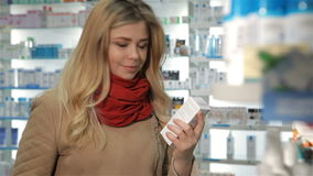 Female customer shows her thumb up at the drugstore stock footage