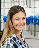 Female Customer Smiling In Hardware Shop Stock Image