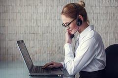 Female customer support emloyee talking online Royalty Free Stock Image
