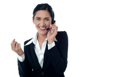 Female customer support executive on call Royalty Free Stock Image