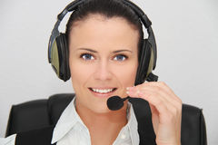 Female customer support operator with headset. Photo of the Female customer support operator with headset Stock Image