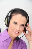 Female customer support operator with headset. Photo of the Female customer support operator with headset Royalty Free Stock Photography