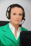 Female customer support operator with headset. Photo of the Female customer support operator with headset Royalty Free Stock Image
