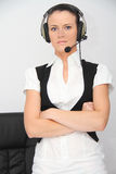 Female customer support operator with headset. Photo of the Female customer support operator with headset Stock Photos