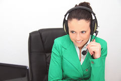 Female customer support operator with headset. Photo of the Female customer support operator with headset Royalty Free Stock Images