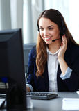 Female customer support operator with headset. And smiling royalty free stock photos
