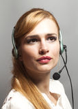 Female customer support operator with headset and smiling isolat Royalty Free Stock Photos