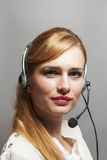Female customer support operator with headset and smiling Stock Image