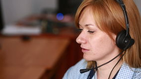 Female customer support operator. she leads online consultation using web camera stock video footage