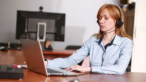 Female customer support operator. she leads online consultation using web camera