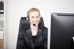 Female Customer Support Sitting at her Office Stock Image