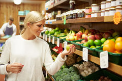 Female Customer At Vegetable Counter Of Farm Shop Royalty Free Stock Photo