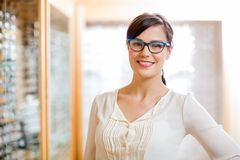 Female Customer Wearing Glasses In Store Stock Image