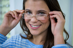 Female customer wearing spectacles in optical store Stock Photography